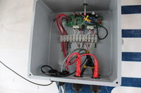 A WrenDAQ3 field modified to act as a weather station for Cordova High School. Attached are a solar insolation sensor, rain gauge, and temperature and relative humidity sensor. It measures battery voltage and current from the 30 watt solar panel mounted above the door.
