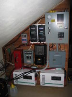 Inverters, controllers, and wiring. This off-grid hybrid solar and wind system powers a home and home business. It has evolved over 20+ years. APRS World repaired and upgraded many of the components in the system. For cost and other reasons the owners chose not to have the system upgraded to meet NEC code. Through APRS World's efforts the owners once again have ample safe and reliable energy available.