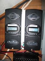 Twin Outback MX60 charge controllers charge the 12 volt battery bank. The MX60's are fed by a 540 watt and 660 watt array.