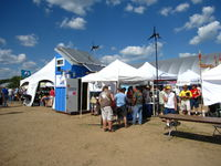APRS World's s-kid with Chinook Turbines' and Midnite Solar's booths