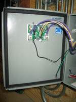 Data logger is mounted through the enclosure door. Current conditions are visible to verify system operation.