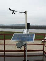 The weather station in testing outside of APRS World's shop. That is the Mississippi River in the background.