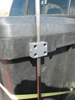"A block of PVC plastic attaches the 1/2"" stainless steel tubing to the tool box. #10-24 machine screws hole the PVC block to the tool box. Anemometer height can be adjusted simply by loosening the screw on the side."