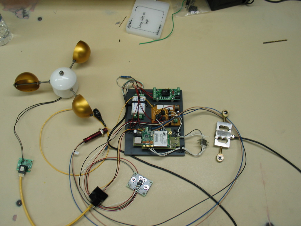 Prototype on bench. Includes anemometer, RPM sensor, load cell, current sensor, voltage inputs, and wireless connectivity. All hand assembled and quite a mess.
