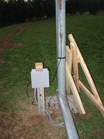Junction box for power and wind sensor cables. Flexible conduit goes about 5 feet up the tower.
