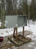 Weather station enclosure constructed from scrap materials. The box came from a scap metal dumpster in Iowa. The pallet and the slightly burned 2x4's were found on site. A chainsaw was used to precisely mitre cut everything.