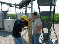 "The solar powered wind data logger is simply bolted to the 4""x4"" post. The post is set in concrete."