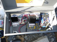 Experimental enclosure. The 24 volt turbine output can be switched to this enclosure. There is a Morningstar Tri-Star MPPT running wind tracking code. It charges the 12 volt battery to the right. The Tri-Star on the left acts as a dump load.