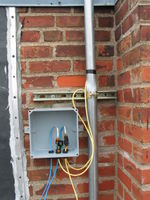 Junction box mounted to the building facade. Lots of room for wiring.