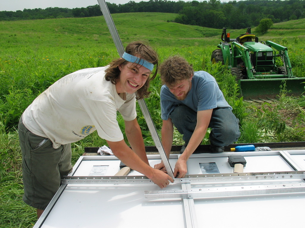 Jesse Smith (left) and Will Hesch (right) work on attaching the panels to the 2 Seas mounts. We were short lots of washers, but otherwise the mounts went together great.