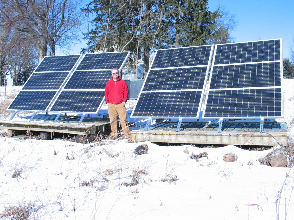 James Jarvis in front of the array, January 2007. Rated at 2.1kW, the array was producing 2096 watts when the photo was taken. This was most likely due to it being 0 degrees F.