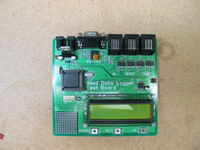 Custom test board that we use for production of the Wind Data Logger. It tests all of the inputs to the Wind Data Logger and shows results on the LCD display.