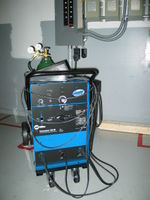 Miller Syncrowave SD180 runner. 180 amp AC/DIG TIG welder. Capable of welding pretty much anything. I run straight argon shielding gas that works fine for aluminum and steel.