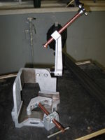 Corner welding fixture. Very nice for making square joints without a lot of setup fuss. Expensive, but worth it.
