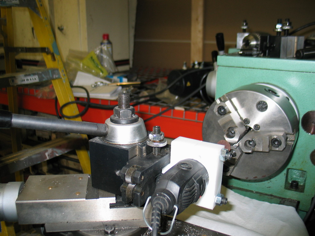 "The 30 minute ""tool post grinder"". Mount was machined from some scrap plastic (probably HDPE)."