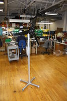 Display stand for small wind turbines. Accommodates any turbine that uses 1.5&quot; schedule 40 pipe. This includes the Chinook 200, and Southwest Wind Power's Air line of turbines.
