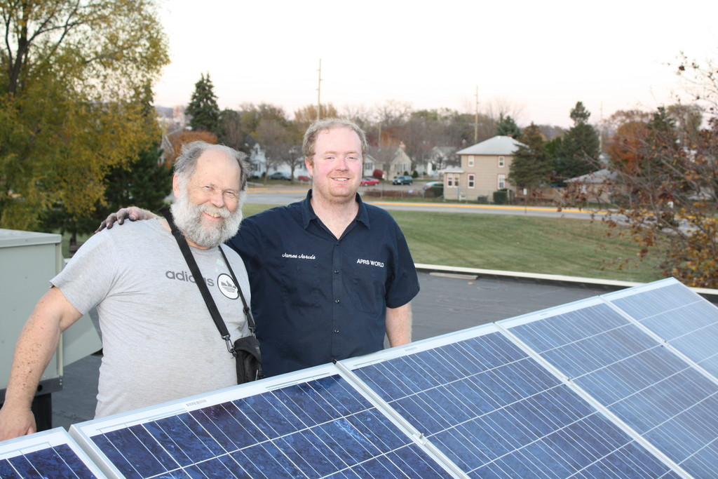 Darryl Thayer and James Jarvis installing a grid tie PV system on a school.
