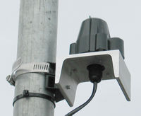 Close up view of Solar Radiation Sensor and APRS World's side of pole mounting bracket.