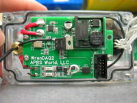 One of two WrenDAQ2 circuit boards. This board has a current sensor (marked U1), a switching power supply module (marked U2), crowbar over voltage protection, and a AC frequency pickup. It connect to the other circuit board with a 10 pin ribbon cable plugged in to J2. The brass hardware on the left attaches the 900 MHz antenna. The white wires on the right are to the weatherproof sensor connector.