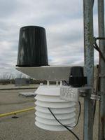 Rain gauge, solar radiation shield with temperature and relative humidity, and solar radiation sensor.