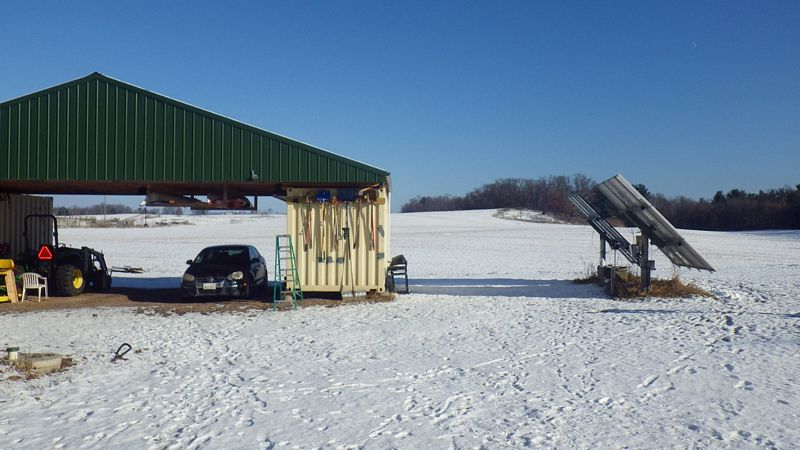 Shipping Container Mounted Solar Array And Garage